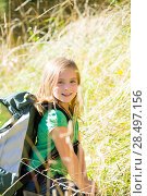 Купить «Blond explorer kid girl walking with backpack between forest grass», фото № 28497156, снято 5 октября 2013 г. (c) Ingram Publishing / Фотобанк Лори