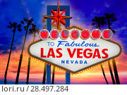 Купить «Welcome to Fabulous Las Vegas sign sunset with palm trees Nevada photo mount», фото № 28497284, снято 17 апреля 2013 г. (c) Ingram Publishing / Фотобанк Лори