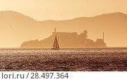 Купить «Alcatraz island penitentiary at sunset backlight sailboat in san Francisco California USA», фото № 28497364, снято 20 апреля 2013 г. (c) Ingram Publishing / Фотобанк Лори