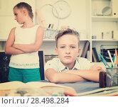 Купить «Brother is sitting offended», фото № 28498284, снято 7 августа 2017 г. (c) Яков Филимонов / Фотобанк Лори