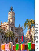 Купить «Valencia Ayuntamiento city town hall with fallas colorful flags in spain», фото № 28499116, снято 22 апреля 2019 г. (c) Ingram Publishing / Фотобанк Лори