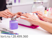 Купить «Nails saloon woman nail polish remove with tissue for new manicure», фото № 28499360, снято 18 ноября 2013 г. (c) Ingram Publishing / Фотобанк Лори