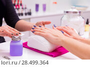 Купить «Nails saloon woman nail polish remove with tissue for new manicure», фото № 28499364, снято 18 ноября 2013 г. (c) Ingram Publishing / Фотобанк Лори