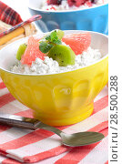 Купить «Cottage cheese in yellow bowl with kiwi, grapefruit and mint», фото № 28500288, снято 15 августа 2018 г. (c) Ingram Publishing / Фотобанк Лори