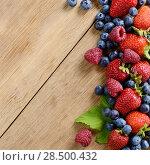 Купить «Strawberries raspberries and blueberries on the wooden table macro», фото № 28500432, снято 16 августа 2013 г. (c) Ingram Publishing / Фотобанк Лори