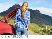 Young woman near broken car needs assistance looking under opened hood. Стоковое фото, фотограф Olena Mykhaylova / Ingram Publishing / Фотобанк Лори