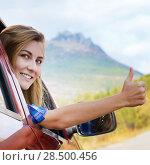 Купить «Happy driver woman shows thumb up against mountains background. Travel vacations concept», фото № 28500456, снято 26 сентября 2013 г. (c) Ingram Publishing / Фотобанк Лори