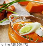 Купить «Homemade Thanksgiving Pumpkin Soup in glass Bowl. Healthy eating concept.», фото № 28500472, снято 30 ноября 2013 г. (c) Ingram Publishing / Фотобанк Лори