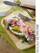 Купить «Bacon and fried eggs open sandwich on the cut board», фото № 28500548, снято 14 января 2014 г. (c) Ingram Publishing / Фотобанк Лори