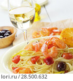 Купить «Seafood spaghetti pasta dish with shrimps and cherry tomatoes served with white wine», фото № 28500632, снято 20 января 2014 г. (c) Ingram Publishing / Фотобанк Лори