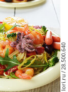 Купить «Seafood spaghetti pasta dish with octopus, shrimps, cherry tomatoes and olives», фото № 28500640, снято 20 января 2014 г. (c) Ingram Publishing / Фотобанк Лори