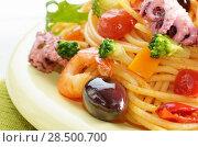 Купить «Seafood spaghetti pasta dish with octopus shrimps cherry tomatoes and olives», фото № 28500700, снято 26 апреля 2019 г. (c) Ingram Publishing / Фотобанк Лори