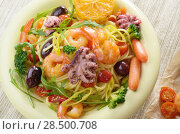 Купить «Seafood spaghetti pasta dish with octopus, shrimps, cherry tomatoes and olives», фото № 28500708, снято 17 октября 2018 г. (c) Ingram Publishing / Фотобанк Лори
