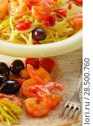 Купить «Seafood spaghetti pasta dish with shrimps cherry tomatoes and olives», фото № 28500760, снято 26 апреля 2019 г. (c) Ingram Publishing / Фотобанк Лори