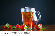 Купить «Sweet compote of ripe red strawberries in a glass decanter on a table», видеоролик № 28500908, снято 31 мая 2018 г. (c) Peredniankina / Фотобанк Лори