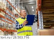 Купить «warehouse worker with clipboard in safety vest», фото № 28503716, снято 9 декабря 2015 г. (c) Syda Productions / Фотобанк Лори