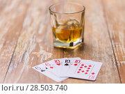 Купить «glass of whisky and playing cards on table», фото № 28503740, снято 24 ноября 2017 г. (c) Syda Productions / Фотобанк Лори