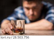 Купить «drunk man with glass of alcohol on table at night», фото № 28503756, снято 24 ноября 2017 г. (c) Syda Productions / Фотобанк Лори