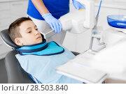 Купить «dentist making x-ray of kid teeth at dental clinic», фото № 28503840, снято 22 апреля 2018 г. (c) Syda Productions / Фотобанк Лори
