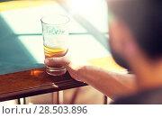 Купить «close up of man drinking beer at bar or pub», фото № 28503896, снято 2 июня 2016 г. (c) Syda Productions / Фотобанк Лори