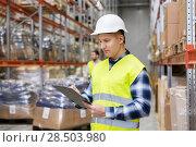 Купить «warehouse worker with clipboard in safety vest», фото № 28503980, снято 9 декабря 2015 г. (c) Syda Productions / Фотобанк Лори