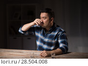 Купить «man drinking alcohol at night», фото № 28504008, снято 24 ноября 2017 г. (c) Syda Productions / Фотобанк Лори