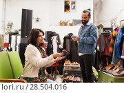 Купить «couple choosing footwear at vintage clothing store», фото № 28504016, снято 30 ноября 2017 г. (c) Syda Productions / Фотобанк Лори