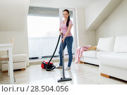 Купить «woman or housewife with vacuum cleaner at home», фото № 28504056, снято 29 апреля 2018 г. (c) Syda Productions / Фотобанк Лори