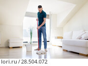 Купить «man with mop and bucket cleaning floor at home», фото № 28504072, снято 10 мая 2018 г. (c) Syda Productions / Фотобанк Лори