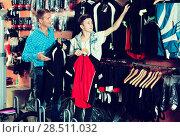 Купить «Boy with man choosing sport jackets for cycling», фото № 28511032, снято 27 сентября 2016 г. (c) Яков Филимонов / Фотобанк Лори