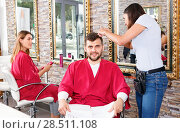 Купить «Portrait of man professional hairdresser near woman client with magazine in salon», фото № 28511108, снято 25 апреля 2018 г. (c) Яков Филимонов / Фотобанк Лори