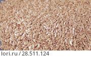 Купить «Flax seeds in bulk», видеоролик № 28511124, снято 23 апреля 2018 г. (c) Потийко Сергей / Фотобанк Лори