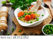 Купить «Chicken soup with green peas», фото № 28512052, снято 22 декабря 2017 г. (c) Надежда Мишкова / Фотобанк Лори