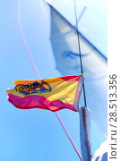 Yachts Ensign of Spain waving in the wind against blue sky background. (2018 год). Стоковое фото, фотограф Alexander Tihonovs / Фотобанк Лори
