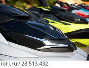 Water scooters in a row. Стоковое фото, фотограф Alexander Tihonovs / Фотобанк Лори