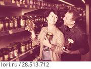 Купить «Couple among the shelves with cucumbers», фото № 28513712, снято 20 июня 2019 г. (c) Яков Филимонов / Фотобанк Лори