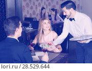 Купить «Polite waiter bringing ordered dishes to smiling couple at restaurant», фото № 28529644, снято 8 января 2018 г. (c) Яков Филимонов / Фотобанк Лори