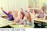 Купить «Students taking active part in discussion», фото № 28529732, снято 9 апреля 2020 г. (c) Яков Филимонов / Фотобанк Лори
