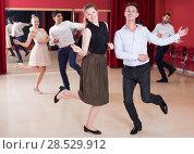 Купить «People dancing twist», фото № 28529912, снято 24 мая 2017 г. (c) Яков Филимонов / Фотобанк Лори