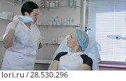 Купить «Beautiful woman gets an injection in her face», видеоролик № 28530296, снято 24 мая 2017 г. (c) Vasily Alexandrovich Gronskiy / Фотобанк Лори