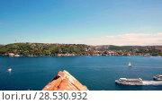 Купить «Bridge on Bosphorus connecting the european waterside of Istanbul with the asian waterside on background of blue sky», видеоролик № 28530932, снято 2 июня 2018 г. (c) Mikhail Starodubov / Фотобанк Лори