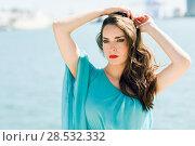 Купить «Beautiful young woman with blue eyes wearing blue dress in the beach», фото № 28532332, снято 26 апреля 2016 г. (c) Ingram Publishing / Фотобанк Лори