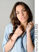 Купить «Young casual woman style over gray background. studio portrait female model. Beautiful smiling happy girl.», фото № 28532432, снято 18 мая 2013 г. (c) Ingram Publishing / Фотобанк Лори
