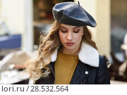 Купить «Blonde russian woman in urban background. Beautiful young girl wearing beret, black leather jacket and mini skirt standing in the street. Pretty female with long wavy hair hairstyle.», фото № 28532564, снято 24 января 2017 г. (c) Ingram Publishing / Фотобанк Лори