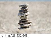 Купить «Pebbles in balancing on the sea coast», фото № 28532668, снято 22 февраля 2014 г. (c) Ingram Publishing / Фотобанк Лори