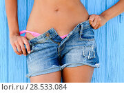 Купить «Close up of a woman in jeans texas shorts», фото № 28533084, снято 30 июля 2012 г. (c) Ingram Publishing / Фотобанк Лори