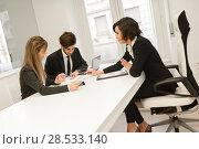 Купить «Image of business partners discussing documents and ideas at meeting», фото № 28533140, снято 14 января 2014 г. (c) Ingram Publishing / Фотобанк Лори