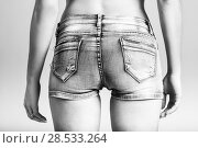 Купить «Back view of woman wearing denim shorts on white background», фото № 28533264, снято 12 января 2016 г. (c) Ingram Publishing / Фотобанк Лори