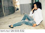 Купить «Portrait of a young black woman, model of fashion in urban background», фото № 28533532, снято 10 марта 2012 г. (c) Ingram Publishing / Фотобанк Лори