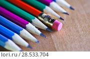 Купить «Black lead pencils lie in a row, one pencil has an eraser on the end, small depth of sharpness», фото № 28533704, снято 5 марта 2016 г. (c) Куликов Константин / Фотобанк Лори